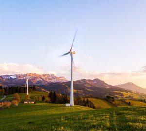 A wind turbine in a grassy field